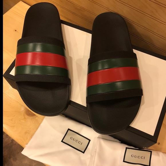 7933ee52e20 Men s Gucci Rubber Slide Sandal